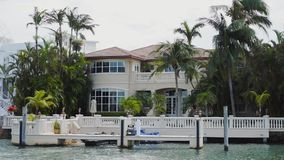 Beautiful mansions of celebrities with private docks for mooring boats and yachts on the bay`s shore ,sunny isles beach. Wonderful estates of famous wealthy stock video footage
