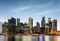 Wonderful evening view of downtown in Singapore. Fantastic skyscrapers and other modern buildings are visible on blue sky background. Amazing colorful city royalty free stock photo