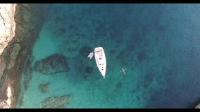 Wonderful filming, aerial video of a beautiful sailboat anchored in an isolated cove, on the island of Mallorca. Paradise stock video footage