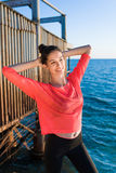 Wonderful fit female working out in summer day Stock Image