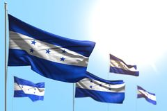 Wonderful 5 flags of Honduras are wave against blue sky illustration with bokeh - any holiday flag 3d illustration. Pretty any holiday flag 3d illustration stock illustration