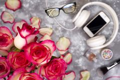 Composed of the roses and mobile phone on the back of a blurry background royalty free stock photo