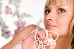 Wonderful girl with beads Stock Photos