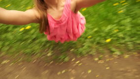 Wonderful girl spinning in the park. stock video footage