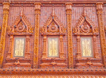 Wonderful glazed tile windows in Thailand temple. Three wonderful windows made from glazed tile in a temple of Bangkok, Thailand Royalty Free Stock Photo