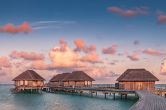 Wonderful golden hour at tropical beach resort in Maldives Royalty Free Stock Photography