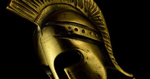 A wonderful golden spartan helmet as part of the equipment of ancient Greek soldiers