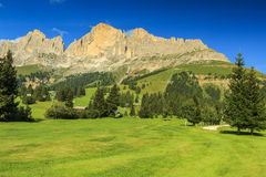 Wonderful golf course and Dolomites in background,Sudtirol,Italy. Golf course,cable car and beautiful landscape in Dolomites,South Tyrol,Italy Stock Photos