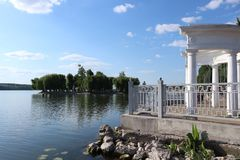 Wonderful green island on the city lake royalty free stock photos