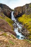 Wonderful and high waterfall Fardagafoss near Egilsstadir on Eas. Tern Iceland, summer time royalty free stock image