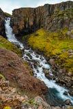 Wonderful and high waterfall Fardagafoss near Egilsstadir on Eas. Tern Iceland, summer time royalty free stock images