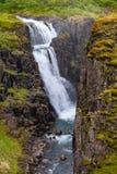 Wonderful and high waterfall Fardagafoss near Egilsstadir on Eas. Tern Iceland, summer time royalty free stock photography