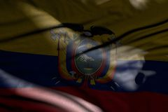 Wonderful illustration of dark Ecuador flag with folds lying flat in shadows with light spots on it - any feast flag 3d. Pretty memorial day flag 3d illustration vector illustration