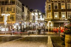 Image at night of a quiet december street with christmas lights decoration stock photography