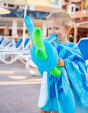 Wonderful kid plays with balloons royalty free stock photography