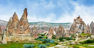 Wonderful landscape with ancient church at Cappadocia, Anatolia, Turkey. Volcanic mountains in Goreme national park. stock photos