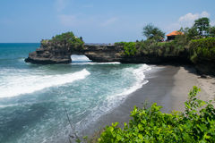 Wonderful landscape: bay with huge wave and black sand from your dream vacation. Beach with black sand in Bali Stock Images