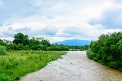 A wonderful landscape in the Carpathians with a river on the background stock image