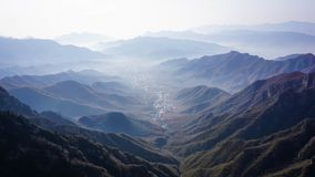 Wonderful landscape of a Chinese village from the top of the Great Wall of China. Mountains royalty free stock photo
