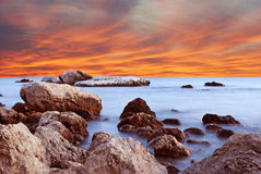 Wonderful landscape with sunset on the beach on the seashore in Stock Images