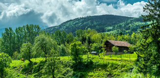 Wonderful landscape with village in mountains Stock Photos