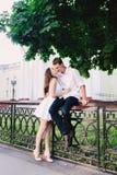 Wonderful leggy gentle girl kissing her man royalty free stock photography