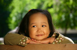 Wonderful Life. The three-year beautiful Korean girl covered by the sun Royalty Free Stock Image