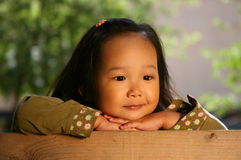 Wonderful Life. The three-year beautiful Korean girl covered by the sun Stock Photography