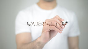 Wonderful Life, man writing on transparent screen. High quality Royalty Free Stock Photos