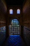Wonderful light inside the Torre de Cemares. Arcade in Alhambra with arabesques Royalty Free Stock Images