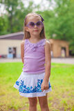 Wonderful little girl in sunglasses walking at Royalty Free Stock Photo