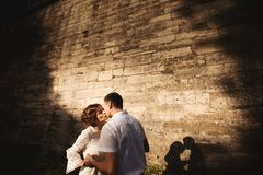 A wonderful love story. Young couple walking around the old wall of castle. Black and white stock photos