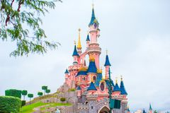 Wonderful magic princess castle at fairy-tale park. Wonderful magic pink castle for princess stock photography