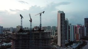 Aerial footage of unfinished construction and beautiful hotels on sunny isles beach,miami. Wonderful miami hotels on the shore of atlantic ocean on the stock footage