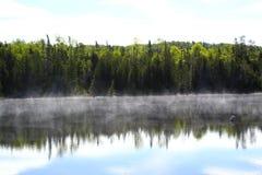 Wonderful misty lake in Canada stock photography