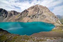 Wonderful mounatin lake Ala-Kul, Kyrgyzstan Royalty Free Stock Photo