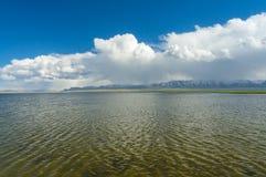 Wonderful lake Son-Kul. Wonderful mountain lake Son-Kul with blue sky and beautiful clouds Royalty Free Stock Photo