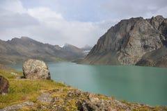 Wonderful mountain landscape lake, highland, peak. Beauty world, stone, grass Stock Images