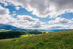 Wonderful mountainous countryside in early autumn. Beautiful sky. exploration and adventure concept royalty free stock photography