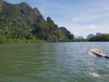 Wonderful mountainous landscape at a kayak trip into the mangrove forest in Ao Thalaine in Krabi in Thailand, Asia. Wonderful mountainous landscape at a kayak royalty free stock photo