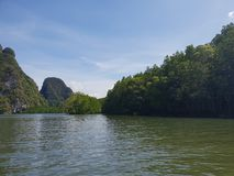 Wonderful mountainous landscape at a kayak trip into the mangrove forest in Ao Thalaine in Krabi in Thailand, Asia. Wonderful mountainous landscape at a kayak royalty free stock images