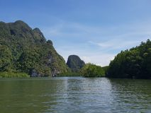 Wonderful mountainous landscape at a kayak trip into the mangrove forest in Ao Thalaine in Krabi in Thailand, Asia. Wonderful mountainous landscape at a kayak stock image