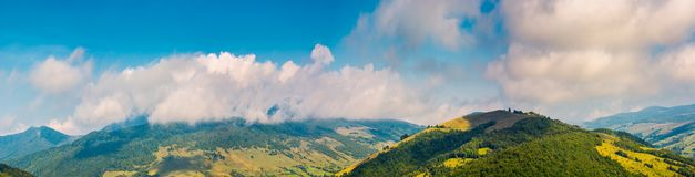 Wonderful mountainous panorama in autumn. Gorgeous cloudscape over the mountain stock images