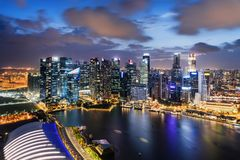 Wonderful night view of skyscrapers at downtown of Singapore. Colorful city lights reflected in water of Marina Bay. Beautiful cityscape. Singapore is a stock photo