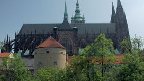 Wonderful old gothic building of Saint Vitus Cathedral, panoramic side view. In sunny day stock video footage