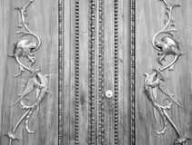 Wonderful old italian door carved on wood with golden dragons. Royalty Free Stock Photos