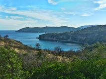 Sealandscape of Acquarilli on Elba Island, Italy. Wonderful panorama from Acquarilli beach. White boats on the background of the blue sky. This place is located stock photography