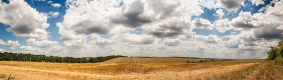 Wonderful panorama of countryside with cloudy sky and harvested Stock Photography