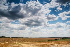 Wonderful panorama of countryside with cloudy sky and harvested Royalty Free Stock Image