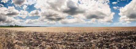 Wonderful panorama of countryside with cloudy sky and harvested Royalty Free Stock Photo
